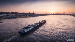 Sunset in Nijmegen (explored) (Lennard Laar) Tags: sunset nijmegen sun waal river water boat ship colors skyline evening nikon d750 tokina 1116mm lennard laar lennardlaar photography netherlands nederland rivier zonsondergang explored expore