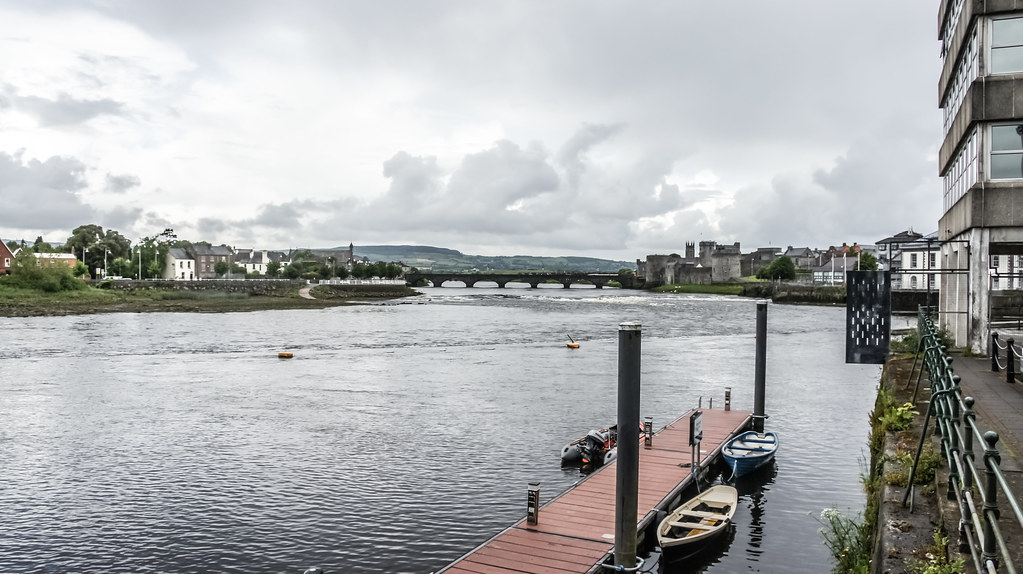THOMOND BRIDGE AND KING JOHN'S CASTLE IN THE DISTANCE AS SEEN FROM HONAN'S QUAY