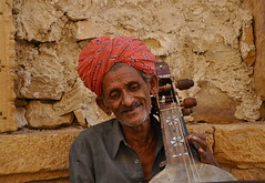 He Made the Strings Sing (The Spirit of the World) Tags: portrait india desert unescoworldheritagesite turban trade jaisalmer rajasthan streetmusician mansions musican stringinstrument traderoute ancienttraderoute havalis portraitofanindianmusician