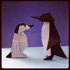 Mother Penguin with her baby. Designs by John Montroll and folded by me. #origami