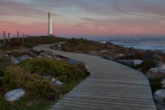 033x - Guiding Light (ClareC79) Tags: sunset sea lighthouse seascape beach canon southafrica rocks capetown boardwalk canon1740mmf4 33100 slangkoplighthouse canon5dmkii image33 100xthe2014edition 100x2014 image33100
