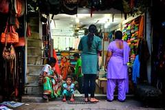Fabric Stall (Daniel Russell2) Tags: street people woman india girl nikon child market delhi 2014 d7000 newdehlipaharganj