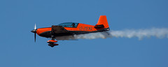 Extra 300 (The Crewe Chronicler) Tags: sky canon aircraft smoke flight aeroplane airshow southport aerobatic airdisplay baldes theblades 60d canon60d southportairshow