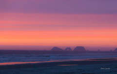 3 Arch Rocks Sunset (telazac) Tags: ocean statepark park light sunset red orange 3 seascape water colors night oregon canon landscape three lowlight sand rocks arch purple unitedstates tillamook low lookout cape grainy hazy waterscape pacificocrean t5i cloudsstormssunsetssunrises