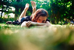 Hiding (Film by Emily) Tags: selfportrait lyingdown bokeh grass blur redhair film canonae1 colours colour outdoors outside summer sun garden girl green