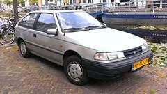 Hyundai Pony 1.5i LS (sjoerd.wijsman) Tags: auto holland cars netherlands car silver grey gray nederland thenetherlands delft voiture pony vehicle holanda autos hyundai paysbas olanda hatchback fahrzeug niederlande zuidholland zilver carspotting hyundaipony hcar carspot sidecode5 hhpl70