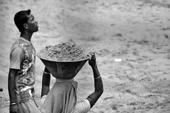 Let me check first (WritingWthLight) Tags: bw woman india white man black work site construction sand nikon indian sigma labour 70300mm d5200