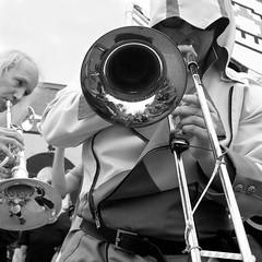 (heatherbirdtx) Tags: street blackandwhite musician music man reflection male festival composition austin community texas play availablelight candid band trombone horn jam brass d20 2014 honktx nerdfunk