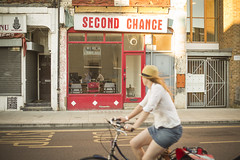 Second Chance (Michael Goldrei (microsketch)) Tags: street old sunset woman sun hot green london girl bike bicycle st shop set photography evening photo day photographer cyclist photos dusk 14 year july sunny cycle second chance stoke newington tattered hottest n16 lanes 2014 stokey sunniest