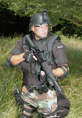 Police Tactical Officer with M4 Commando (rcsadvmedia) Tags: police sheriff raid colt swat ar15 srt eotech bushmaster bodyarmor m4carbine tacticalteam specialweaponsandtactics tactteam policetactical