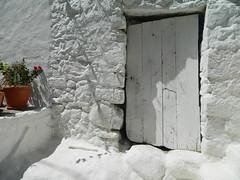 white door (Bichoes) Tags: nisyros dodekanse aegean mandraki spiliani monastery knights castle greece