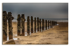Holding back the Waves (Ian Emerson) Tags: decay groyne beach sand timber wood structure sea coastline coastal yorkshire seascape canon framed minimal lines row sandsend
