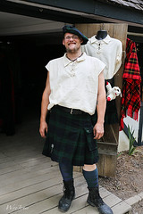 Kilt Salesman (wyojones) Tags: county man smile hat festival socks shop shirt tattoo beard glasses store belt pin texas kilt village boots ellis scottish clothes cap lad faire vendor bonnet renaissance renfest tam gentleman pompom tamoshanter waxahachie shoppe shopkeeper tos elliscounty scarboroughrenaissancefestival toorie wyojones shoppekeeper