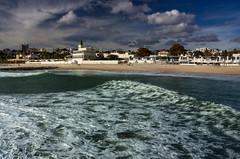Estoril surfscape (snowyturner) Tags: beach portugal clouds landscape pier surf waves lisbon estoril polariser