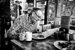 An eye for breakfast (Darren Athersmith) Tags: food man cup face breakfast menu bread mono glasses bacon cafe beans tea eating egg sausage coke mug fujifilm cooked fried bx xt1