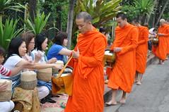 The monks do not smile or greet anyone (oldandsolo) Tags: southeastasia earlymorning buddhism tourists lp laos luangprabang buddhistmonk laopdr makingmerit unescoworldheritagecity buddhistreligion takbat buddhistfaith morningalmsgivingritualluangprabang morningalmsgivinginluangprabang