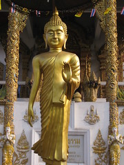 Beautiful gold Buddha in a walking pose (shankar s.) Tags: thailand southeastasia buddha buddhism chiangmai wat highstreet buddhisttemple norththailand buddhistshrine watbuppharam buddhistreligion chiangmaistreet buddhistfaith chiangmaitraffic downtownchiangmai