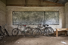 """DSC_3716_bikes_in_classroom_kassanda_secondary • <a style=""""font-size:0.8em;"""" href=""""http://www.flickr.com/photos/35665144@N00/14788997872/"""" target=""""_blank"""">View on Flickr</a>"""