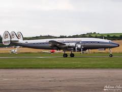 Breitling --- Lockheed L-1049F Super Constellation --- HB-RSC (Drinu C) Tags: plane aircraft sony super duxford lockheed panning dsc constellation breitling qfo flyinglegends egsu hbrsc l1049f hx100v imperialwarmuseums adrianciliaphotography