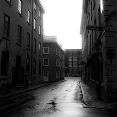 Walking Montreal 003 (noahbw) Tags: road street city light summer bw building wet monochrome architecture square blackwhite nikon pavement oldmontreal explored d5000 noahbw