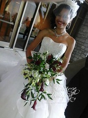 092014Bride (elitedesignsbydaphne) Tags: wedding groom bride feathers bridesmaids bouquet centerpiece rosepetals callalily boutonniere sweethearttable