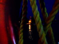 Into the night (peggyhr) Tags: light red lighthouse white lake toronto water closeup night reflections gold ropes iphone ringbuoy peggyhr