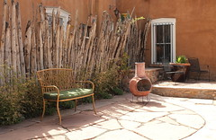 The Bench of Rest (Esther Spektor - Thanks for 5 millions views..) Tags: street city travel plants sunlight newmexico santafe building texture window grass leaves stone wall corner canon fence bench t