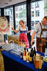 Dacha bartenders (ep_jhu) Tags: woman man cute beer girl smiling glasses dc washington costume mujer pretty fuji dress oktoberfest drinks blonde dcist fujifilm dac bier dacha aia pqliving x100s