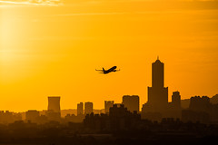 Sunset,Kaohsiung City,Taiwan (Yi-Liang Lai) Tags: city sunset sky sun sunlight color building silhouette yellow canon buildings cityscape aircraft flight taiwan transportation airline kaohsiung     70300mm  6d 70300  85    canon6d