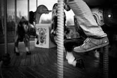 merry-go-round and round (Ceithwyr) Tags: wood bw horse shoe blackwhite carousel sneakers trainers pole nostalgia jeans nostalgic merrygoround