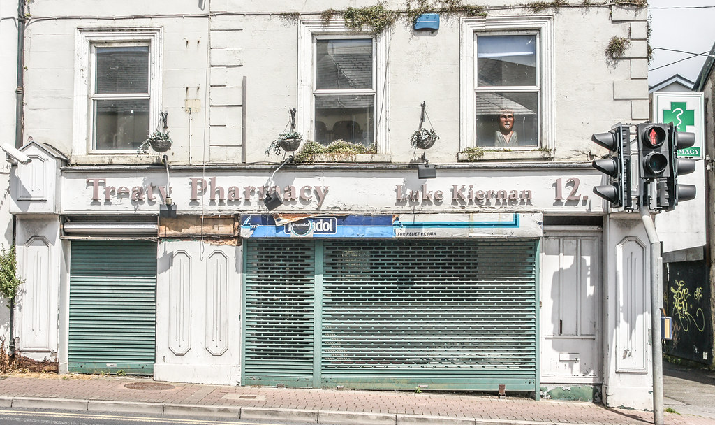 ANOTHER FAILED BUSINESS IN LIMERICK - NOTE THE LONELY CHARACTER IN THE WINDOW [TREATY PHARMACY ON TREATY TERRACE]