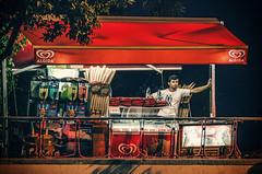 Refreshment and relaxation (Melissa Maples) Tags: summer food man night turkey nikon asia trkiye antalya icecream vendor walls nikkor vr turk afs  18200mm  f3556g  18200mmf3556g d5100