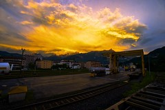 Sunset over the rails (Serpentes Asclpios) Tags: city sunset sun mountains alps industry beautiful station montagne alpes work switzerland evening soleil europe rails soire industrie wallis valais