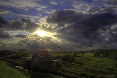 House under the rays (Janslb) Tags: sky house holland netherlands clouds landscape nikon rays huis ijssel landschap hollandseijssel nieuwerkerkadijssel ijsseldijk nikond7000 zuidplas