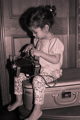touch (marbraza) Tags: camera old baby cute classic girl sepia kids vintage dark photography toddler texas candid flash adorable luggage indoors d100