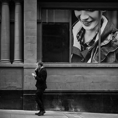 Walking lunch (S.R.Murphy) Tags: leeds september2014 sonynex6 yorkshire street streetphotography mono monochrome blackandwhite west bw nik niksilverefexpro2 lightroom lightroom5 urban urbanscene urbanlandscape man eating pavement sidewalk socialdocumentary