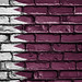 National Flag of Qatar on a Brick Wall