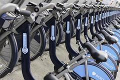 Barclays Cycle Hire, London (basair) Tags: uk blue england bicycle wheel publictransportation bikes cycle boris saddle bicyclerack barclays cityoflondon inarow