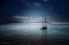 Samos - Bay of Limnionas - Light sea (Pana53) Tags: see bay nikon meer wasser nebel fenster himmel griechenland blick segelschiff horizont samos taverne dunst schlauchboot bucht mittelmeer blickpunkt hügelkette nikond800 ankert pana53 photographedbypana53