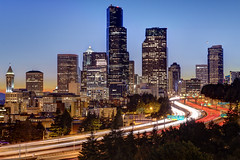 Seattle Skyline Sunset (Patrick Lundgren) Tags: seattle county city blue light sunset red urban orange usa white building tower cars car skyline america canon buildings landscape lights us washington highway long exposure downtown king traffic state pacific northwest i5 united central trails sigma hour freeway interstate sates citysscape