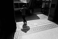 Leaving the arcade. (Johnbasil1) Tags: street light shadow bus shop contrast newcastle fujifilm shopper centralarcade xe1