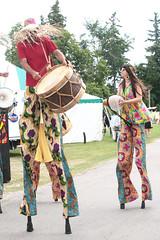 Drumming On High (peterkelly) Tags: ontario canada hat digital drum guelph northamerica drummer drumming hillside stilts stiltwalker 2014 hillsidefestival guelphlakeconservationarea