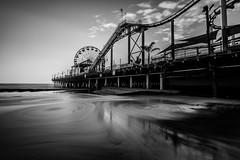 Circles (Chigrboy2012) Tags: santamonica pier black white monochrome california circles wheel sand surf beach