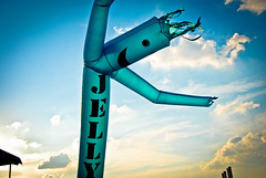 Jelly (...1,000 Words) Tags: blue light sunset sky orange ny newyork yellow clouds contrast concert nikon random balloon perspective jelly unusual d80 airdancer
