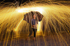 Steel Wool - Umbrella Lights (Cristiano Drago) Tags: light beach umbrella canon fire lights luci spiaggia luce fuoco ombrello steelwool blondegirl 650d lightpanting ilobsterit cristianodrago