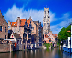 Bruges - Belgian Belfry II (kenny mccartney) Tags: city travel blue panorama holiday tower water beer canon cityscape belgium belgique pano brugge belgi landmark canals unesco belfry le license getty bruges waffles brew flemish iconic gettyimages flanders converter belgien zeebrugge brgge 48mm vertorama 5dii tse24lii 2xiii kennymccartney longexposureshifted