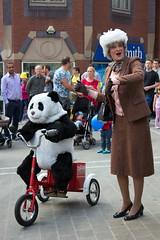 A Panda on a Trike (Maria Spadafora (@BloodyNoraDJ)) Tags: art yellow drums panda tricycle yorkshire trike tourdefrance eyup letour artinnit streettheatre leedscitycentre yorkshirefestival tourdefrance2014 yorkshirefestival2014 pandaonatrike