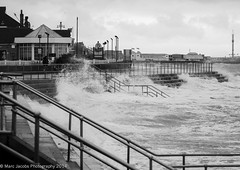 Storm hits Clacton 2 (Marc Jacobs Photography) Tags: sea white kite storm black beach monochrome rain weather lens lumix photography pier seaside waves force wind g hurricane strangers stormy olympus x gale panasonic shore f marc windsurfing 28 hits jacobs essex clacton f28 omd bertha em1 vario 35100mm