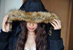 Shy girl (Roving I) Tags: beauty mystery fur longhair smiles enigma vietnam lipstick saigon jackets hcmc hoodies hochiminh shyness anoraks