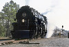 """Norfolk Southern (N&W) A class 2-6-6-4 articulated steam locomotive is preparing to stop after completing a photo run-by with """"The Suwanee Steam Special"""" near Fargo, Georgia, November 1987 (alcomike43) Tags: old people color classic vintage ties switch photo nw track smoke engine photographers slide trains historic steam photograph locomotive freighttrains coal siding spikes articulated steamengine observers railroads 1218 ballast rightofway norfolkwestern norfolksouthern steamlocomotive turnout aclass mainline passengertrains roadbed 2664 coalfired railfans srails tieplates fargogeorgia weldedribbonrail railfanexcursiontrains thesuwaneesteamspecial"""